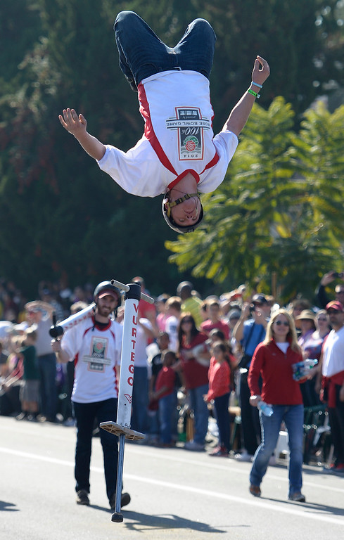 . Xpogo pogo stick rider gets some big air near the end of the parade route during the 2014 Rose Parade in Pasadena, CA January 1, 2014.(John McCoy/Los Angeles Daily News)