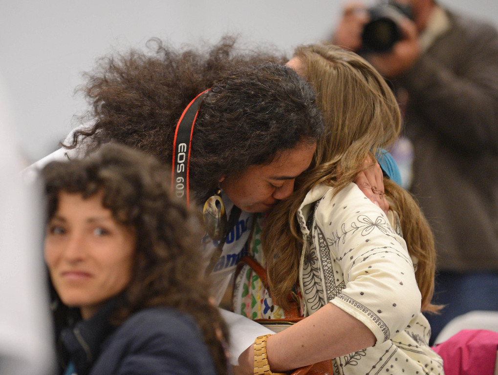 . \'Amelia Niumeitolu, left, and Marci Wayman hug after Wayman made an emotional speech to the LA Harbor Commission meeting to determine the fate of the SCIG rail terminal, or Southern California International Gateway.    Photo by Brad Graverson 3-7-13