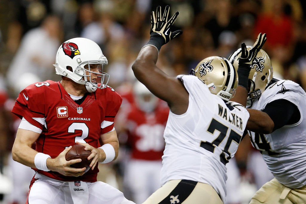 . Carson Palmer #3 of the Arizona Cardinals is sacked by  Tyrunn Walker and  Cameron Jordan #94 of the New Orleans Saints at the Mercedes-Benz Superdome on September 22, 2013 in New Orleans, Louisiana.  (Photo by Chris Graythen/Getty Images)