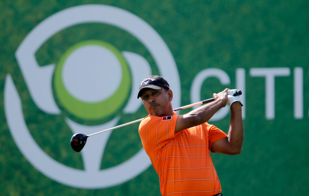 Description of . Jeev Milkha Singh of India watches his shot from the second tee during the fourth and final round of the Dubai Desert Classic at the Emirates Golf Club, February 3, 2013. REUTERS/Jumana El Heloueh