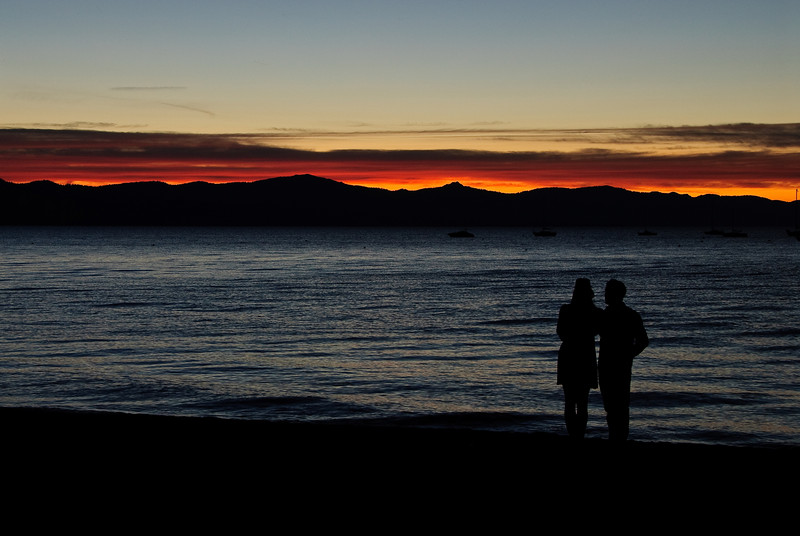 Two lovers enjoying the sunset over Lake Tahoe.