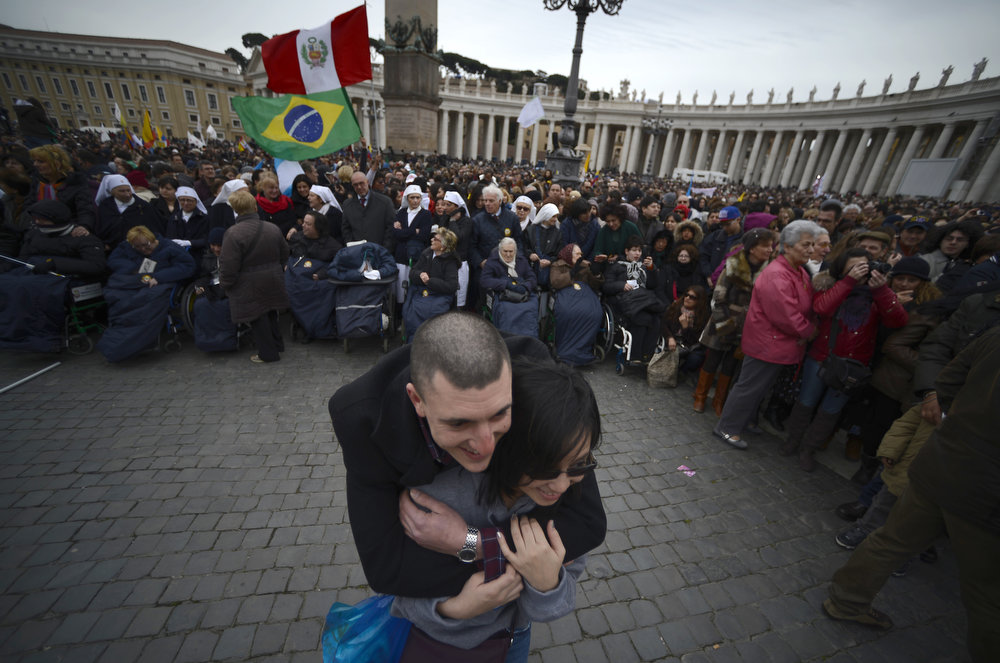 . People wait for pope\'s first Angelus prayer at St Peter\'s square on March 17, 2013 at the Vatican. Pope Francis begins his papacy in earnest today ahead of his formal inauguration mass, with a weekly prayer address used by previous pontiffs to comment on international affairs. The pope\'s first Angelus prayer, delivered from a window high above St Peter\'s Square, is a chance for the first Latin American pontiff to begin to sketch out a more global vision for the role of the Roman Catholic Church.  FILIPPO MONTEFORTE/AFP/Getty Images
