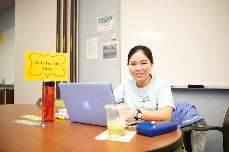 Senior Lien Doan prepares at the Center of Student Achievement for Statistics Tutorials after her classes.