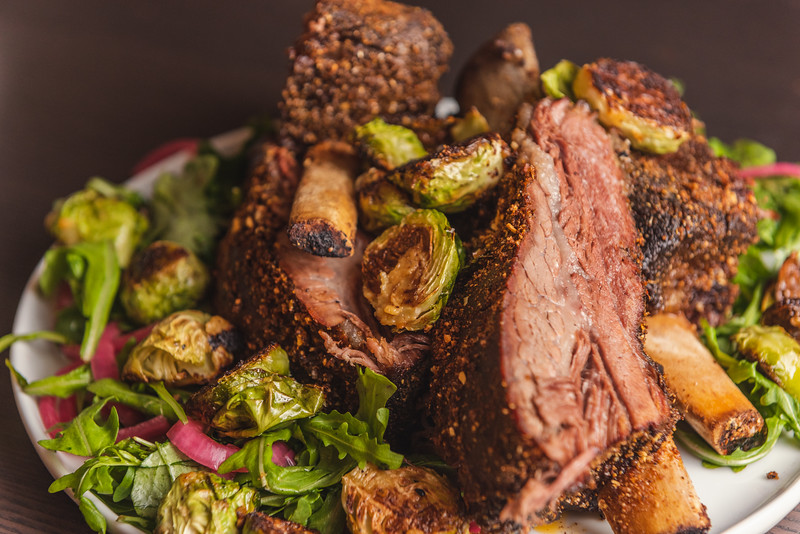 beef short ribs with brussels, pickled onions, and arugula