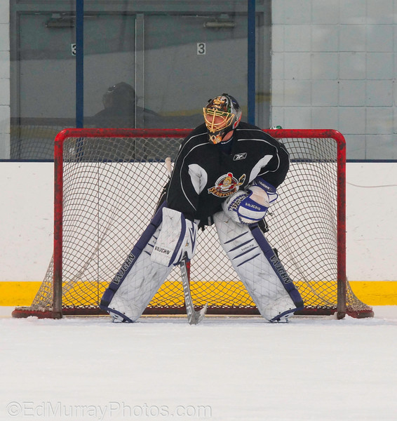 Waiting for a shot: Sorry I wasn't around yesterday - It was an incredibly hectic day. I had a frustrating situation last Sunday. It was my daughter's birthday party - she wanted to go ice skating so we held it at a local rink. I set up two cameras, one on a tripod with a remote and one hand held. I everything ready for the big moment (the cake) - unfortunately my wife and mother -in-law never told my that they decided to do it early..next thing I know, the lights went out the cake came out and I couldn't get to my cameras fast enough. I missed the whole thing. I was soooo upset.   3/26/2013