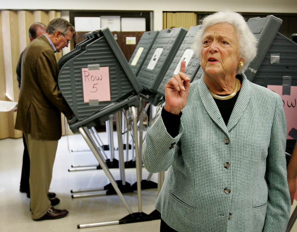 . Former President Bush, left, and his wife former first lady Barbara Bush speaks  during early voting in Houston, TX Monday, Oct. 18, 2004. (AP Photo/Eric Gay)
