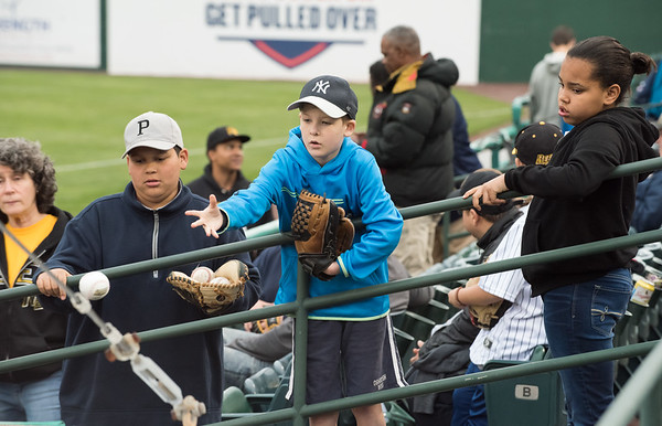 05/03/19 Wesley Bunnell | Staff The New Britain Bees home opener vs the Somerset Patriots on Friday night at New Britain Stadium. Troy Brighthaupt tosses ball to a Bee player for an autograph.