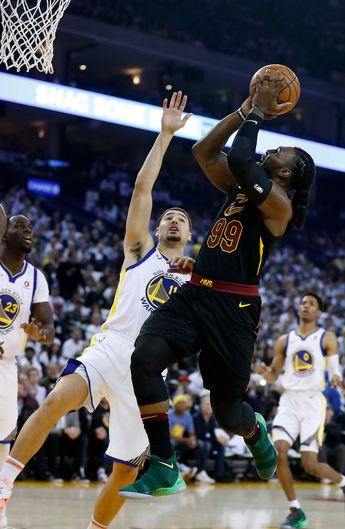 . Cleveland Cavaliers forward Jae Crowder (99) shoots over Golden State Warriors guard Klay Thompson (11) during the first half of an NBA basketball game in Oakland, Calif., Monday, Dec. 25, 2017. (AP Photo/Tony Avelar)