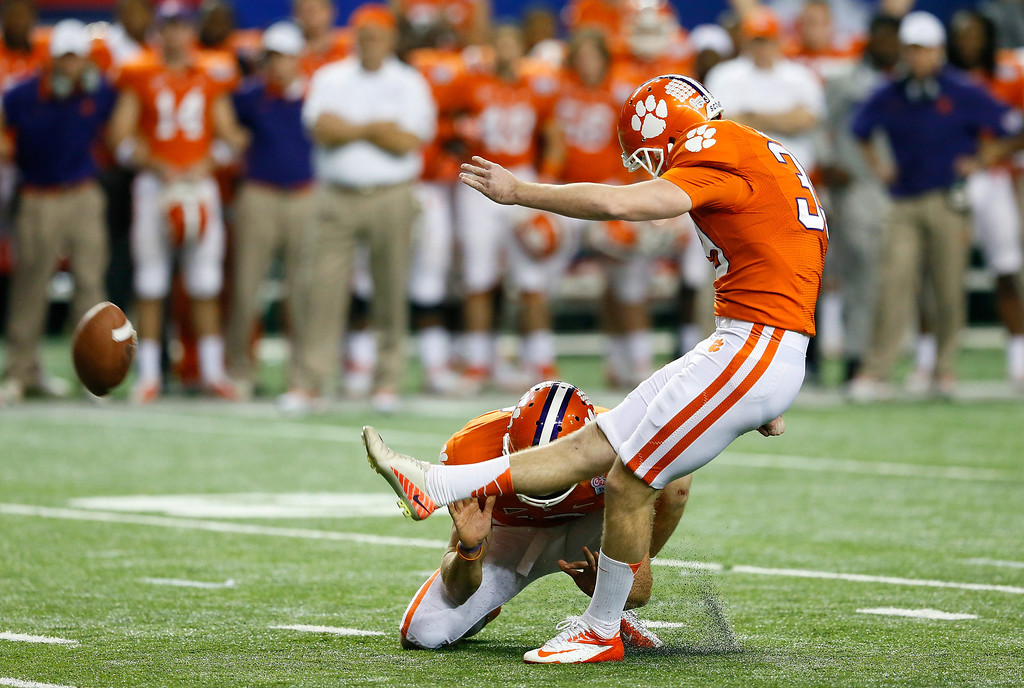 . ATLANTA, GA - JANUARY 01:  Chandler Catanzaro #39 of the Clemson Tigers kicks the game-winning field goal against the LSU Tigers during the 2012 Chick-fil-A Bowl at Georgia Dome on December 31, 2012 in Atlanta, Georgia.  (Photo by Kevin C. Cox/Getty Images)