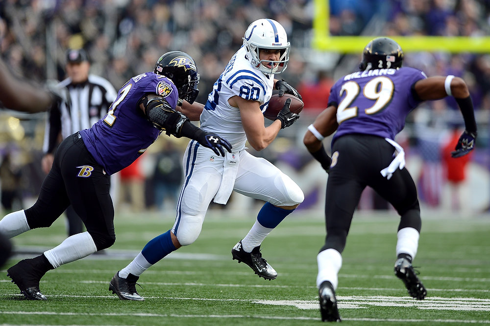 Description of . Coby Fleener #80 of the Indianapolis Colts makes a reception against Ray Lewis #52 and Cary Williams #29 of the Baltimore Ravens during the AFC Wild Card Playoff Game at M&T Bank Stadium on January 6, 2013 in Baltimore, Maryland.  (Photo by Patrick Smith/Getty Images)