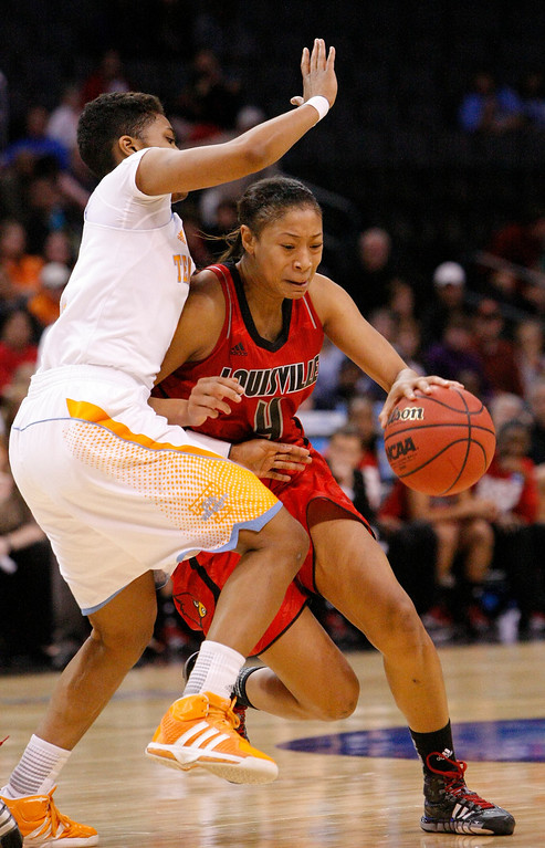 . Tennessee\'s Kamiko Williams, left, defends as Louisville\'s guard Antonita Slaughter (4) drives to the basket during the first half of the regional final in the NCAA women\'s college basketball tournament in Oklahoma City, Tuesday, April 2, 2013.   (AP Photo/Alonzo Adams)