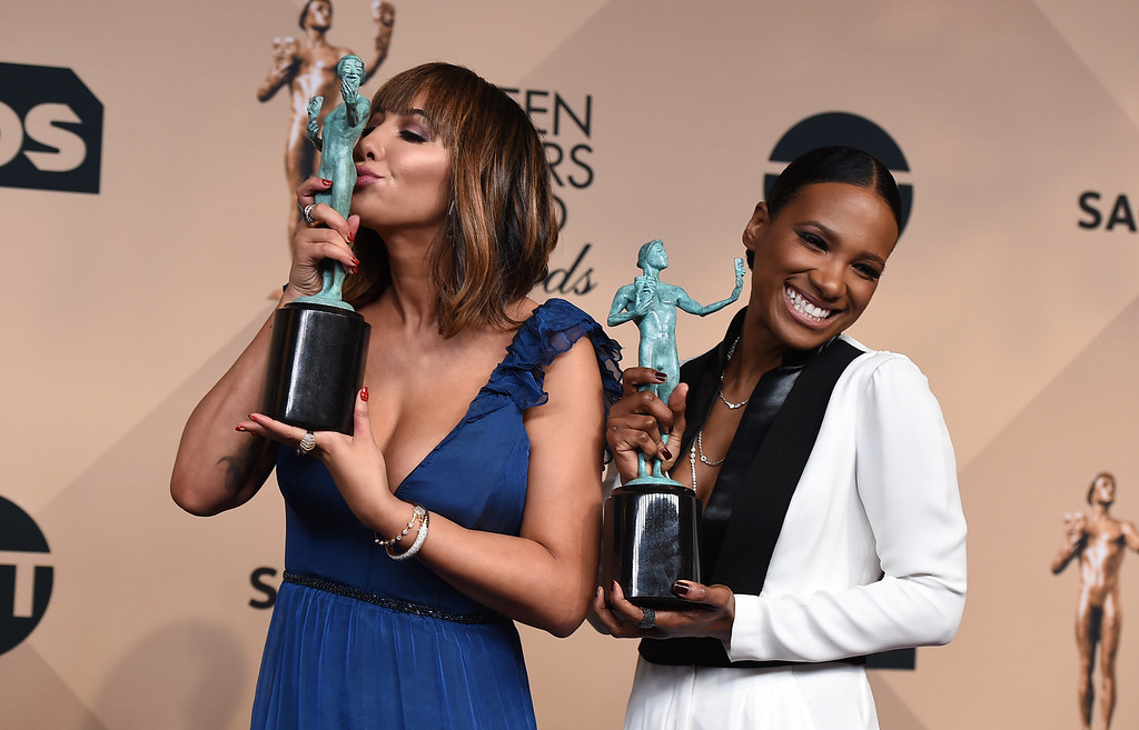 . Jackie Cruz, left, and Vicky Jeudy of \'Orange is the New Black\' accept the award for outstanding ensemble in a comedy series pose in the press room at the 22nd annual Screen Actors Guild Awards at the Shrine Auditorium & Expo Hall on Saturday, Jan. 30, 2016, in Los Angeles. (Photo by Jordan Strauss/Invision/AP)