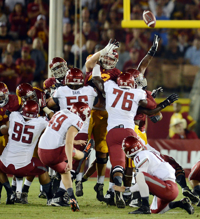 . Washington State\'s Andrew Furney #49 hits the game winning field goal during their game against USC at the Los Angeles Memorial Coliseum  Saturday, September 7, 2013. Washington State beat USC10-7. (Photo by Hans Gutknecht/Los Angeles Daily News)