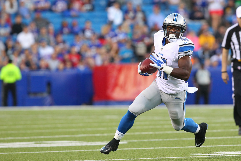 . Detroit Lions running back Theo Riddick (41) runs with the ball against the Buffalo Bills during the first half of a preseason NFL football game, Thursday, Aug. 28, 2014, in Orchard Park, N.Y. (AP Photo/Bill Wippert)