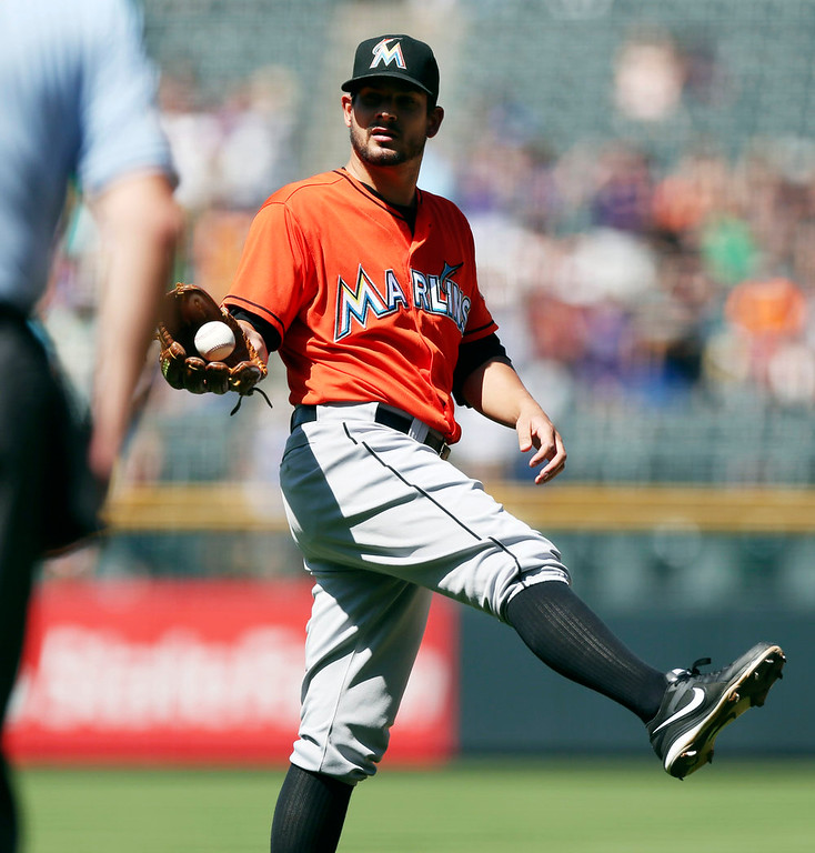 . Miami Marlins starting pitcher Brad Hand calls for a new ball after giving up a two-run home run against the Colorado Rockies in the first inning of a baseball game in Denver on Sunday, Aug. 24, 2014. (AP Photo/David Zalubowski)