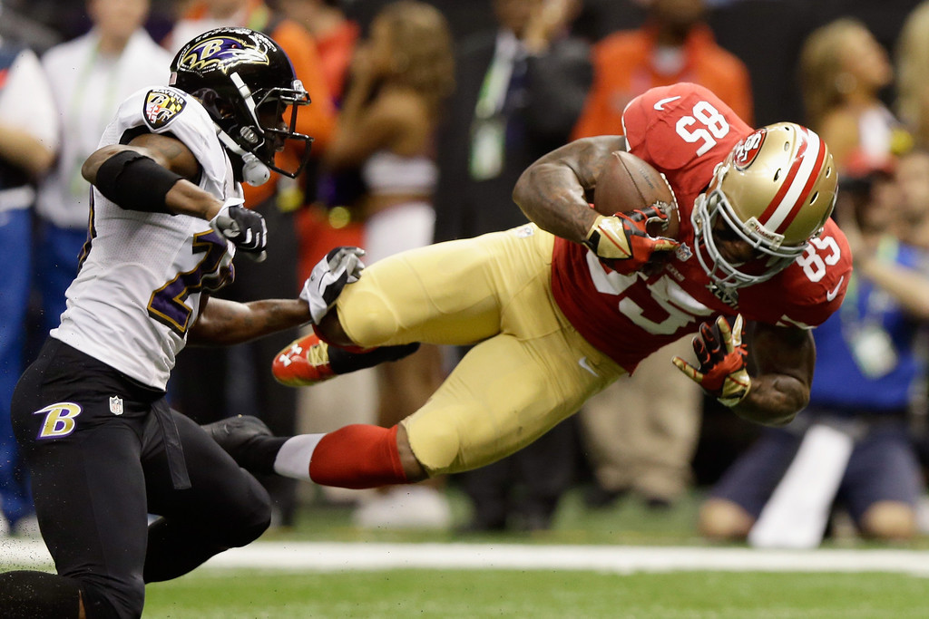 . NEW ORLEANS, LA - FEBRUARY 03: Vernon Davis #85 of the San Francisco 49ers goes airborne after catching a pass against the Baltimore Ravens in the first quarter during Super Bowl XLVII at the Mercedes-Benz Superdome on February 3, 2013 in New Orleans, Louisiana.  (Photo by Ezra Shaw/Getty Images)