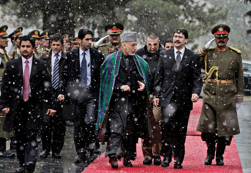 . Hungarian President J·nos ¡der, second right, looks at guards of honor with Afghan President Hamid Karzai after his arrival at the presidential palace in Kabul, Afghanistan, Monday, Dec. 17, 2012. ¡der is on an official visiting to Afghanistan. (AP Photo/Ahmad Jamshid, Pool)