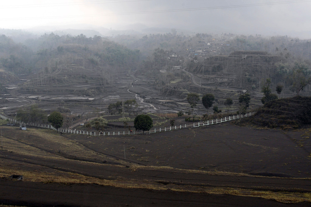 . Volcanic ash from an eruption of Mount Kelud covers a housing area at Pandansari village in Malang, East Java, Indonesia, Sunday, Feb 16, 2014.   (AP Photo/Trisnadi)