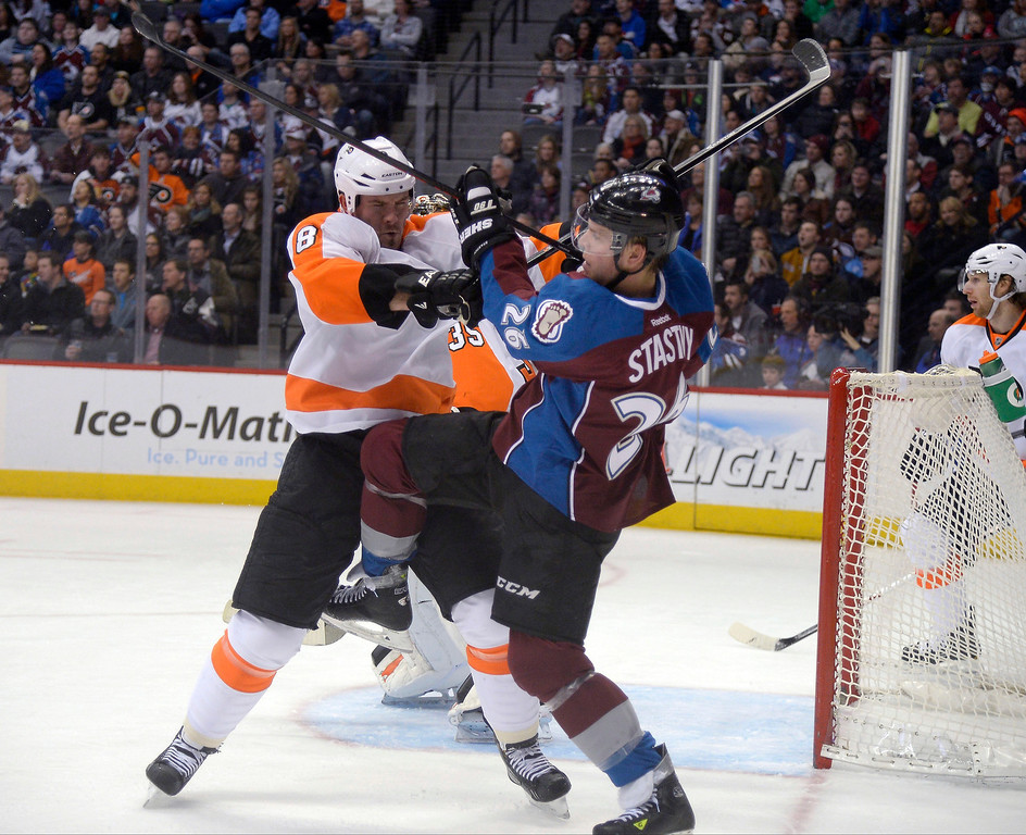 . Colorado Avalanche center Paul Stastny (26) and Philadelphia Flyers defenseman Nicklas Grossmann (8) battle in front of the goal during the first period January 2, 2014 at Pepsi Center. (Photo by John Leyba/The Denver Post)
