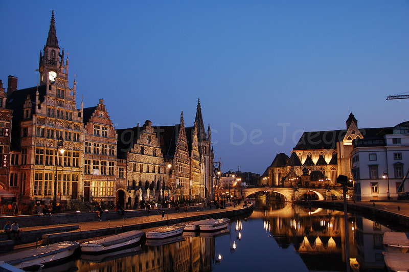 Evening shot of the St Michielsbrug (St Michael's Bridge near the Corn Market, Korenmarkt) and Graslei in the city of Ghent (Gent), Belgium.