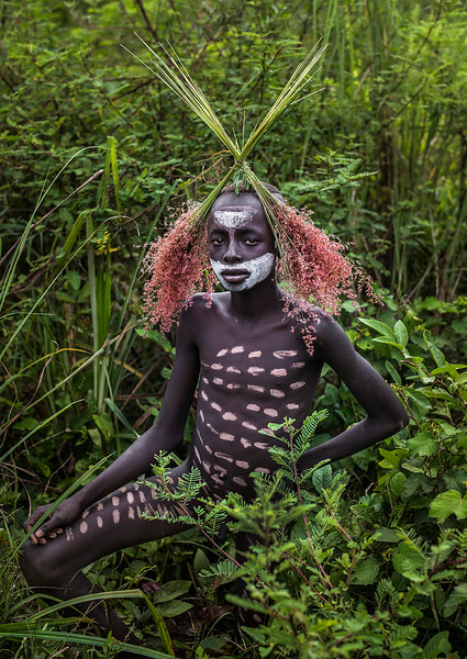 The Suri look beautiful in their decoration but the main reason is to look menacing and command respect. The body painting is also important for tribal celebrations.  Southern Ethiopia, 2017.