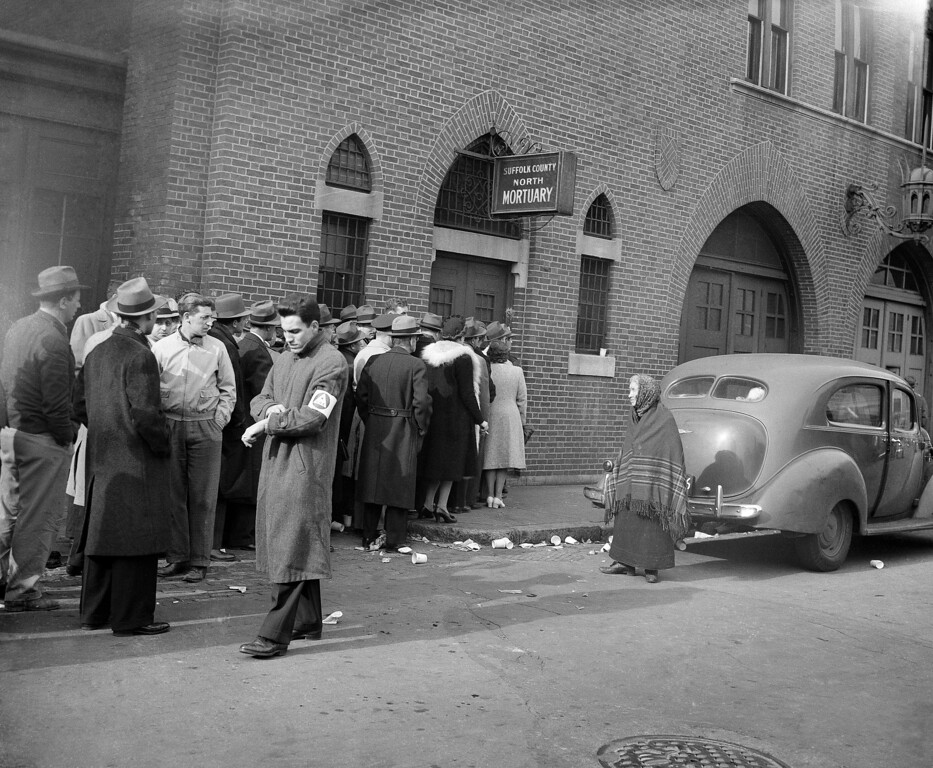 . An unidentified elderly lady seeking her son, missing since the tragic fire at the Cocoanut Grove night club in Boston on November 28, stands bewildered and apart from the crowd of anxious people waiting to enter a morgue in an effort to ascertain if friends or family members were lost, Nov. 29, 1942. (AP Photo)