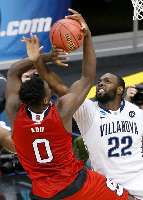 . Villanova\'s JayVaughn Pinkston (22) fouls North Carolina State\'s Abdul-Malik Abu (0) who shoots during the second half of an NCAA college basketball tournament Round of 32 game Saturday, March 21, 2015, in Pittsburgh. (AP Photo/Gene J. Puskar)