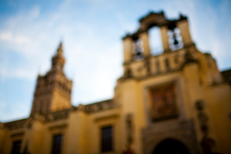 Moody, blurred image of Sevilla's Cathedral north side and Giralda tower, town of Seville, autonomous community of Andalusia, southern Spain