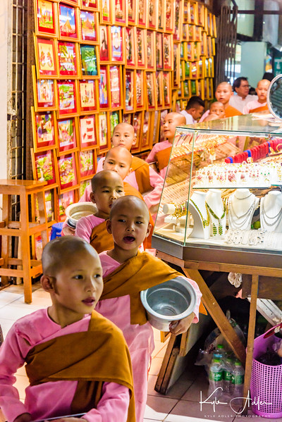 Back in Yangon for our final day before flying out to Hong Kong, we visited the large central Bogyoke Aung San Market, also known as Scott Market.  A group of young novice nuns meanders through the thousands of stalls asking for alms.