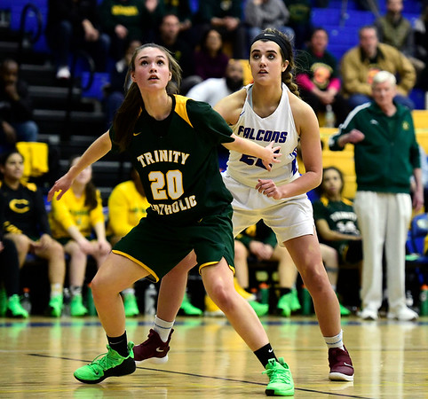 3/8/2019 Mike Orazzi | Staff St. Paul Catholic High School's Morgan Kolb (22) and Trinity Catholic's Kiera Fenske (20) during the Class S Semifinal girls basketball at Newtown High School Friday night in Newtown.
