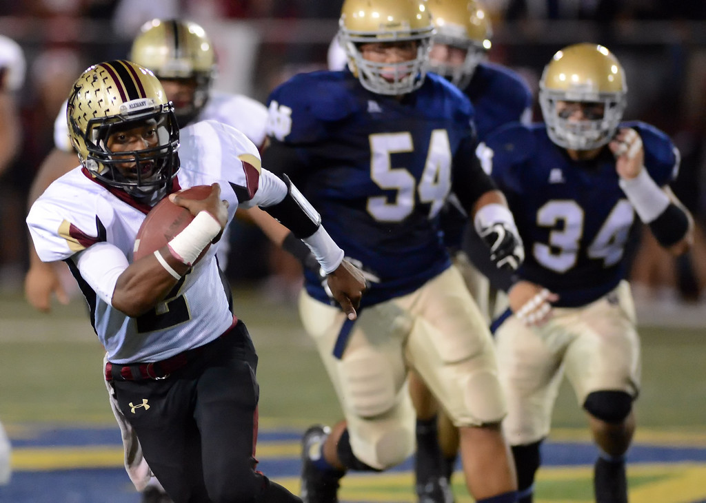 . Alemany\'s Alif Grayes #2 scrambles for a gain during their football game against Notre Dame  at Notre Dame High School Friday, October 18, 2013.  (Photo by Hans Gutknecht/Los Angeles Daily News)