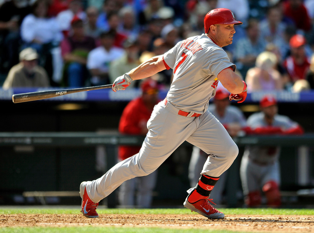 . St. Louis Cardinals\' Matt Holliday runs to first after hitting an RBI single off Colorado Rockies starting pitcher Roy Oswalt (44) during the fifth inning of a baseball game on Thursday, Sept. 19, 2013, in Denver. (AP Photo/Jack Dempsey)