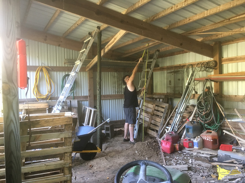 Building shelves and loft in storage shed.