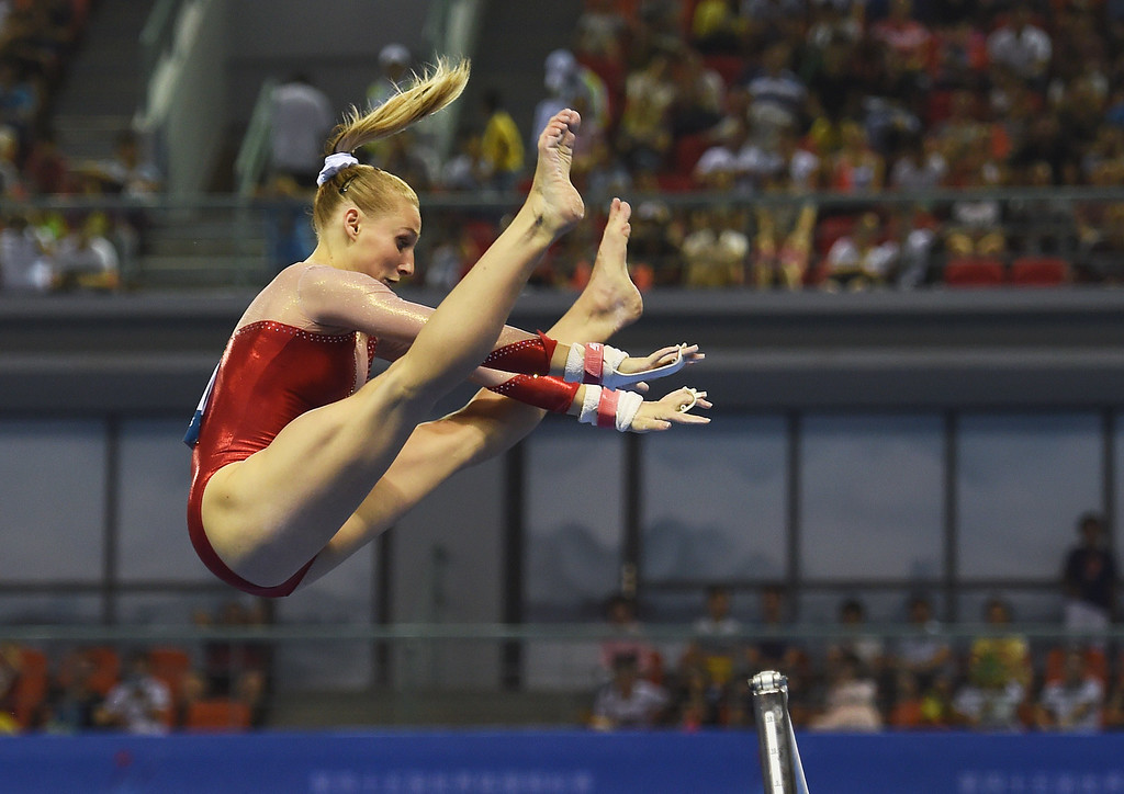 . Marine Brevet of France performs on the uneven bars during the women\'s qualification round at the Gymnastics World Championships in Nanning, in China\'s southern Guangxi province on October 6, 2014. GREG BAKER/AFP/Getty Images