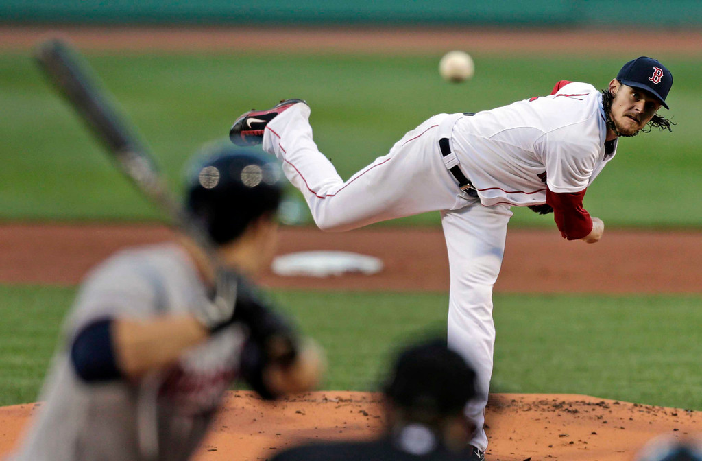 . Boston Red Sox starting pitcher Clay Buchholz delivers during the first inning. (AP Photo/Charles Krupa)