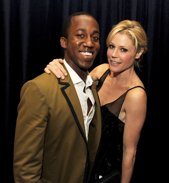 ". Honoree Lenworth Poyser (L) and actress Julie Bowen pose at ""An Evening\"" benifiting The L.A. Gay & Lesbian Center at the Beverly Wilshire Hotel on March 21, 2013 in Beverly Hills, California.  (Photo by Kevin Winter/Getty Images)"