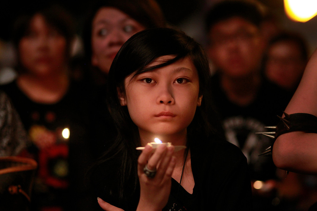 . A young man attends  a candle lit vigil in Taipei, Taiwan, Wednesday, June 4, 2014, to mark the 25th anniversary of the June 4th Chinese military crackdown on the pro-democracy movement in Beijing. (AP Photo/Wally Santana)