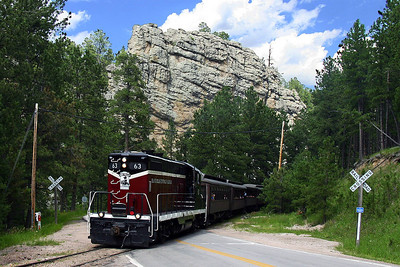 A more contemporary photograph of railroading in the Black Hills.   This is the 1880 Train winding through the hills between Keystone and Hill City, hauling a full load of tourists enjoying the ride and immersing themselves in a bit of history.