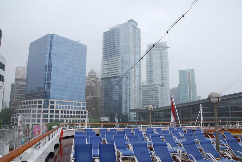 Sunday, May 20th, sailing day.  The weather had turned dreary and rainy.  View of the Vancouver skyline from the ship's rear deck.