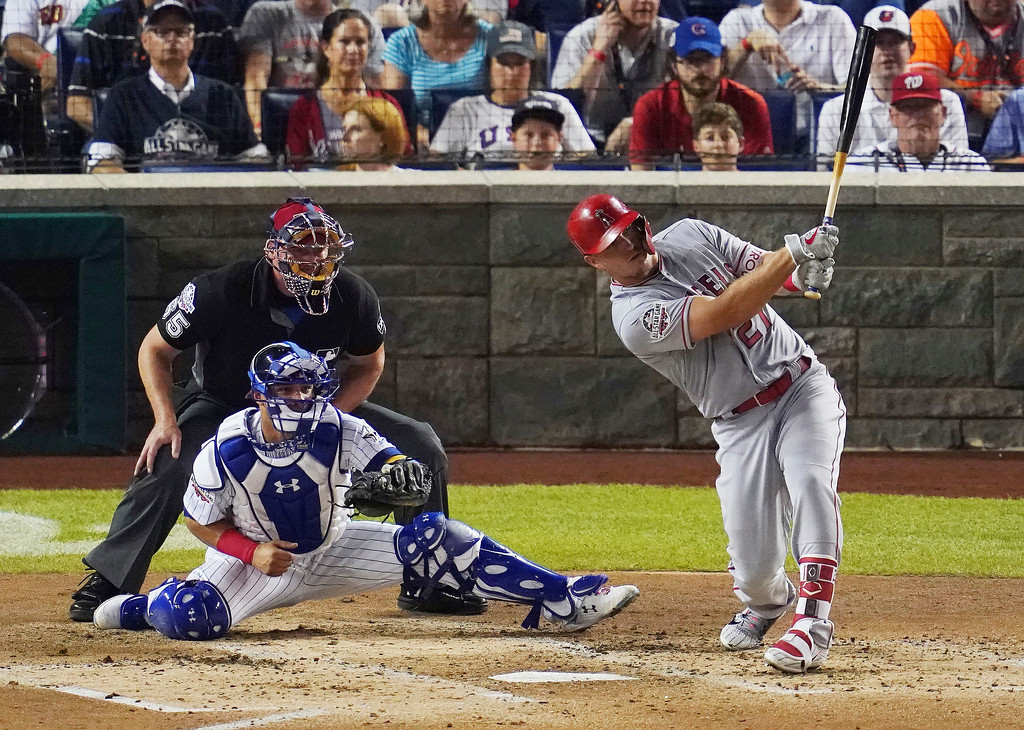 . Los Angeles Angels of Anaheim outfielder Mike Trout (27) hits a solo home run in the third inning during the 89th MLB baseball All-Star Game, Tuesday, July 17, 2018, at Nationals Park, in Washington. (AP Photo/Carolyn Kaster)