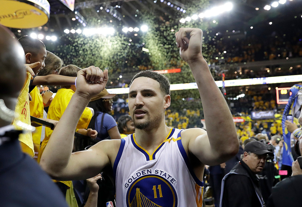 . Golden State Warriors guard Klay Thompson (11) walks off the floor after Game 2 of basketball\'s NBA Finals against the Cleveland Cavaliers in Oakland, Calif., Sunday, June 4, 2017. (AP Photo/Marcio Jose Sanchez)