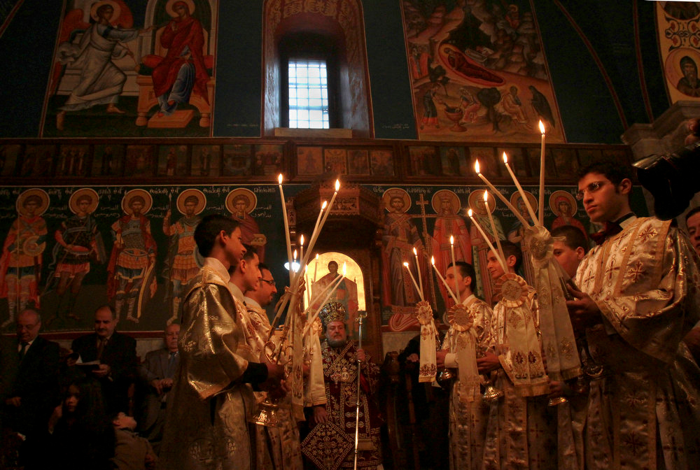 . Greek Archbishop Alexious, leads prayers during Christmas celebrations at a Greek Orthodox church in Gaza City, Monday, Jan. 7, 2013. Several Orthodox communities celebrate Christmas according to the Julian calendar. (AP Photo/Adel Hana)