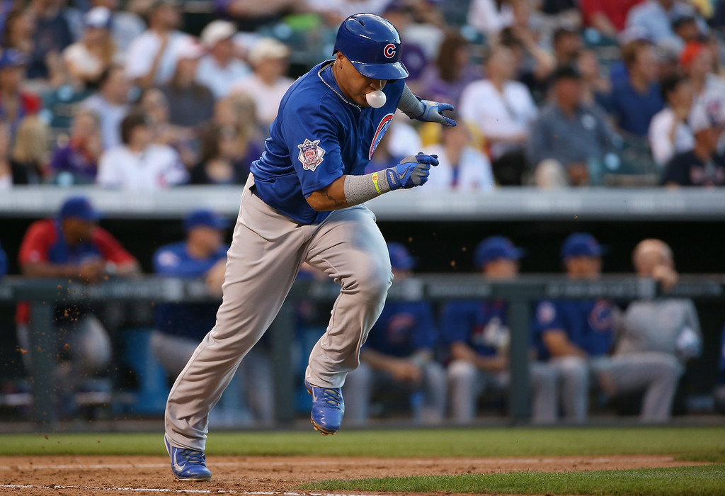 . DENVER, CO - AUGUST 05:  Javier Baez #9 of the Chicago Cubs grounds out against Franklin Morales #56 of the Colorado Rockies in the fourth inning at Coors Field on August 5, 2014 in Denver, Colorado.  (Photo by Doug Pensinger/Getty Images)