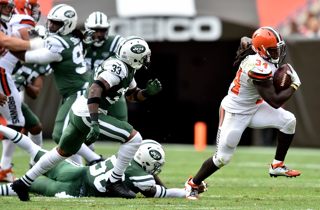 . Cleveland Browns running back Isaiah Crowell (34) rushes against the New York Jets during the first half of an NFL football game, Sunday, Oct. 8, 2017, in Cleveland. (AP Photo/David Richard)