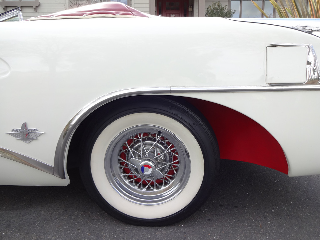 . John Odne\'s 1954 Buick Skylark sports white sidewall tires and 40-spoke chrome wire wheels.   (Photo by David Krumboltz)