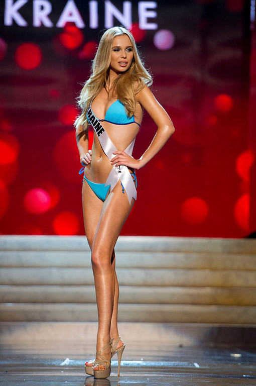 . Miss Ukraine Anastasia Chernova competes in her Kooey Australia swimwear and Chinese Laundry shoes during the Swimsuit Competition of the 2012 Miss Universe Presentation Show at PH Live in Las Vegas, Nevada December 13, 2012. The 89 Miss Universe Contestants will compete for the Diamond Nexus Crown on December 19, 2012. REUTERS/Darren Decker/Miss Universe Organization/Handout