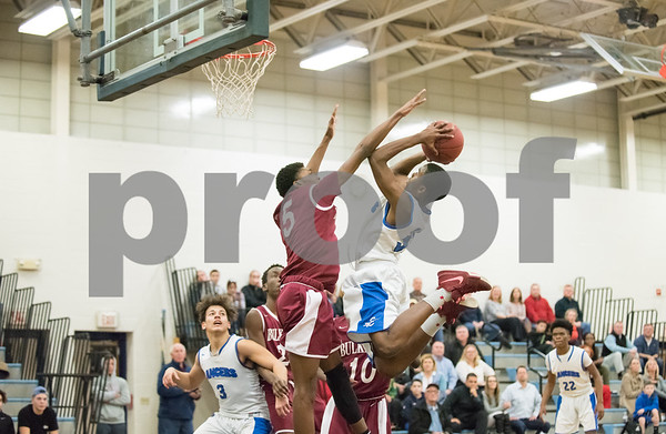 01/25/18 Wesley Bunnell | Staff Bristol Eastern boys basketball defeated Bulkeley 58-54 in OT after trailing for most of the game. Brendon Gayle (35).