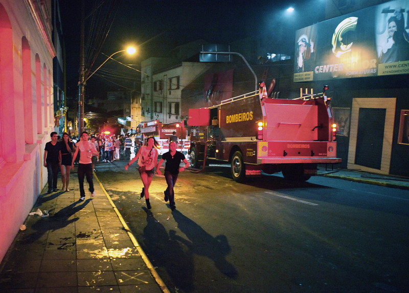 . People run away as firefighters try to put out a fire at a nightclub in Santa Maria, 550 Km from Porto Alegre, southern Brazil on January 27, 2012. The death toll climbed to 150 early Sunday as firefighters searched the charred remains of the establishment, television Globo reported. Brazilian President Dilma Rousseff interrupted her visit to Chile.  Germano Roratto/AFP/Getty Images