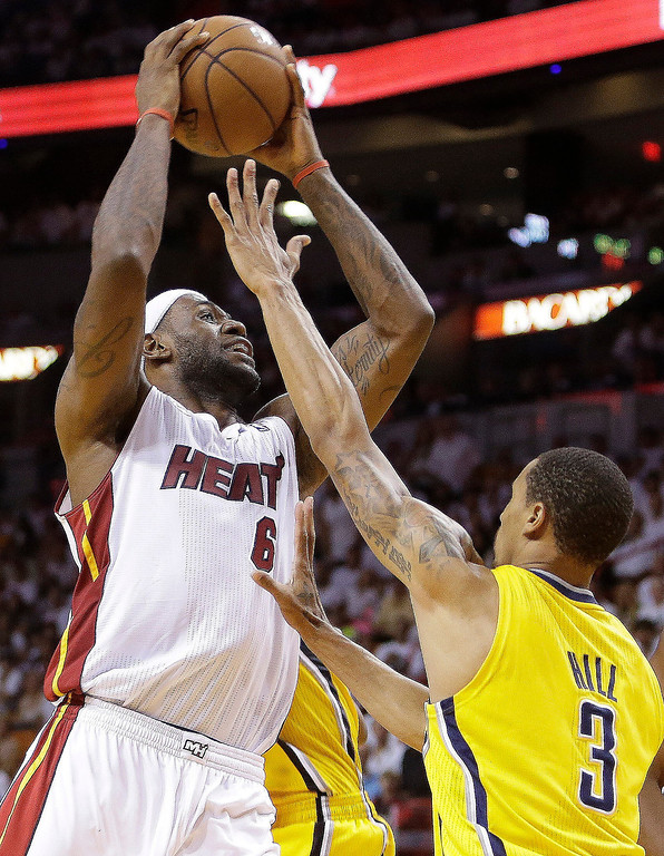. Miami Heat small forward LeBron James (6) works against Indiana Pacers point guard George Hill (3) during the second half of Game 7 in their NBA basketball Eastern Conference finals playoff series, Monday, June 3, 2013 in Miami. (AP Photo/Lynne Sladky)