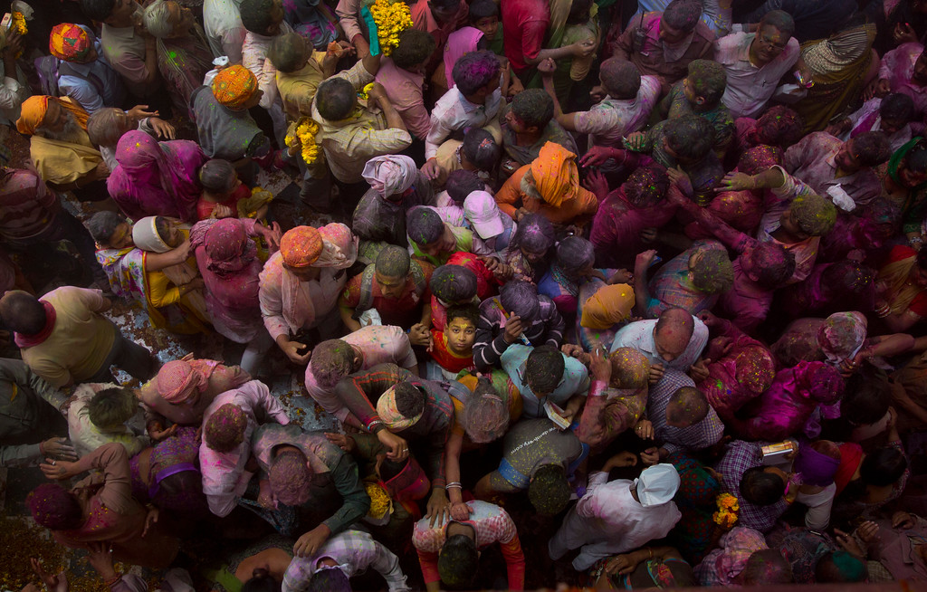 . A boy makes his way out after praying inside Banke Bihari temple, dedicated to Lord Krishna, during Holi festival celebrations in Vrindavan, India, Wednesday, March 8, 2017. Holi, the festival of colors, celebrates the arrival of spring. (AP Photo/Manish Swarup)